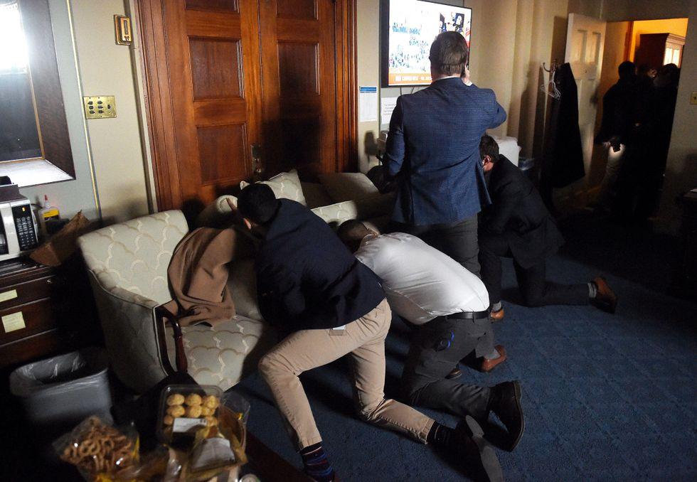 Congressional staffers build barricade