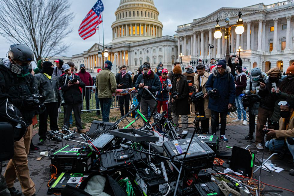 Rioters destroy media equipment