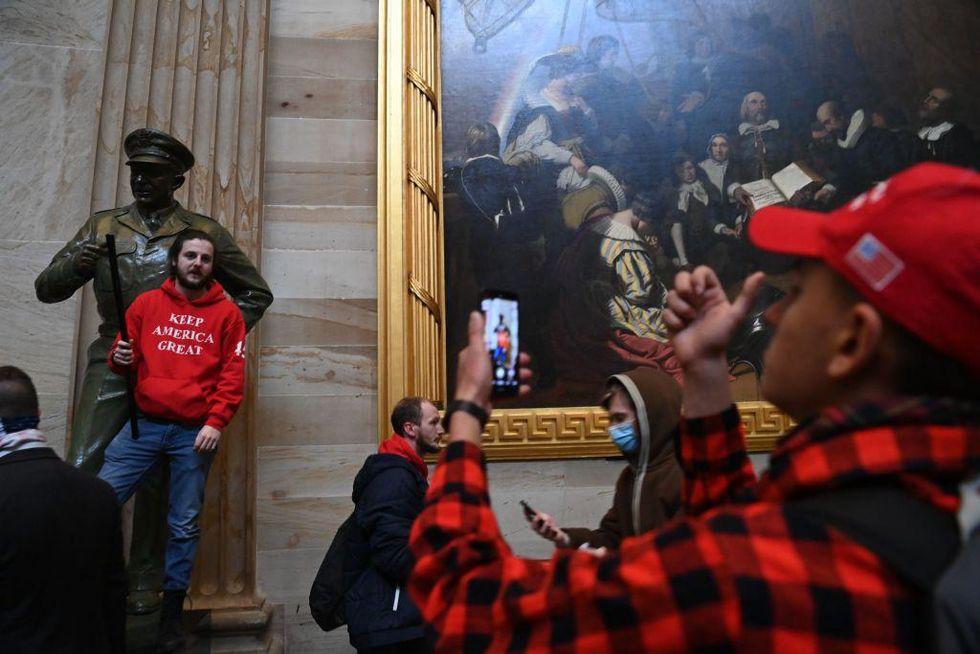 rioter in rotunda at Eisenshower statue