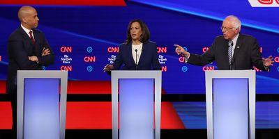 Cory Booker, Kamala Harris and Bernie Sanders at the Democratic presidential debate in October